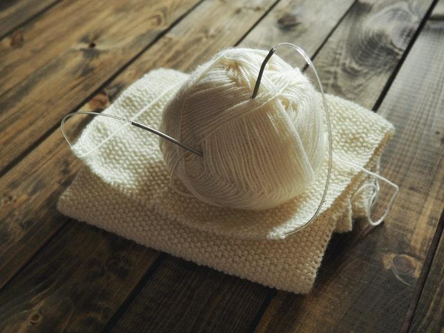 A ball of yarn and knitting needles.